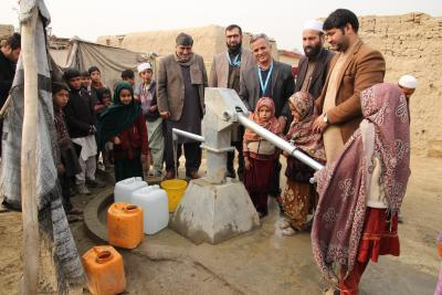 Community accessing clean water through hand pumps