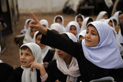 A young girl raises her finger in class at a  a primary school in the northwestern city of Herat, Afghanistan.