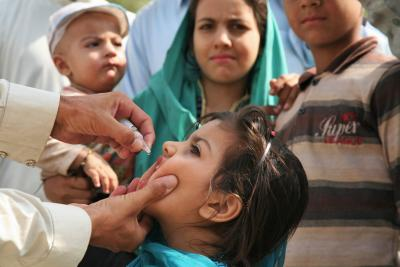 A young girl receives polio vaccine drops at the Torkham border crossing between Afghanistan and Pakistan.