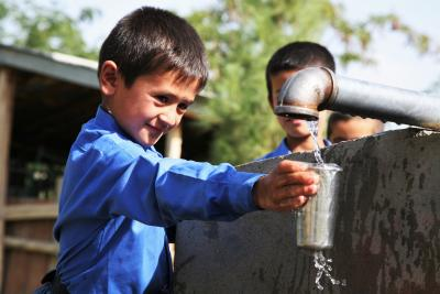 A boy drinks clean water from a hand pump at a school in Faizabad in the northeastern province of Badakhshan, Afghanistan.