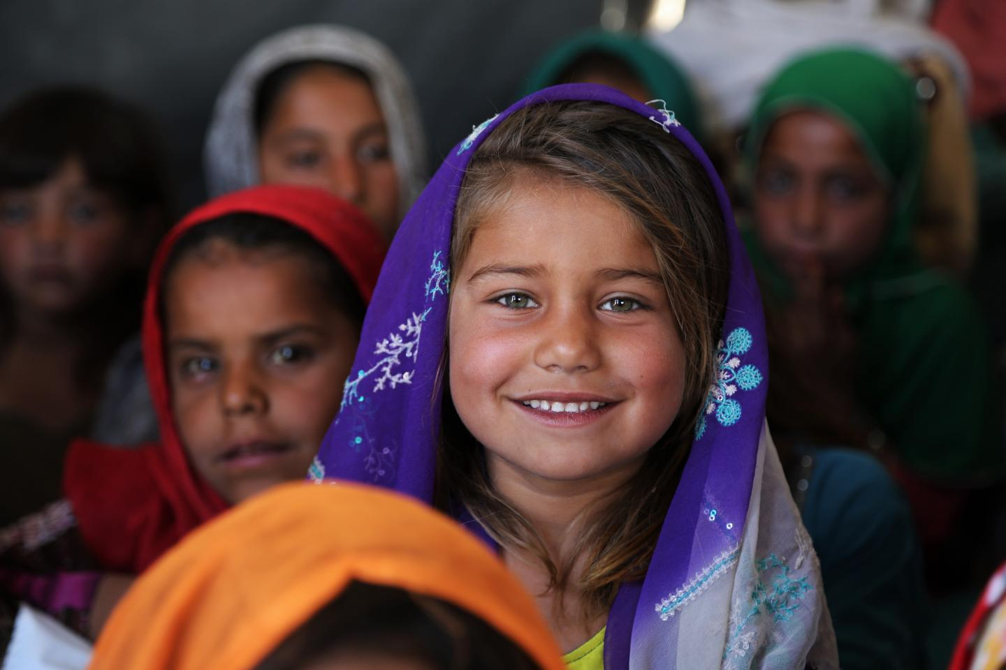 A returnee girl attends a community-based school.