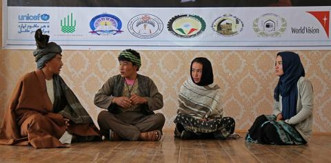 Youth in Bamyan, Afghanista, take part in a role play about child marriage.