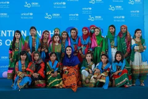 Girls in Kandahar Province, southern Afghanistan, with UNICEF Afghanistan Youth Ambassador Hinna Asefi Wardak (centre) calling for the right to education, play, family, protection and an end to conflict.