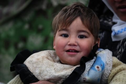 Mohammad, 1.5 years old, is visiting the UNICEF supported mobile health and nutrition team for checkup.