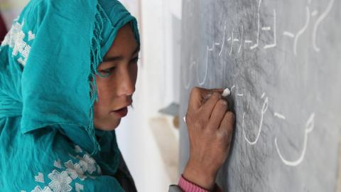 Khadija, writing on a blackboard