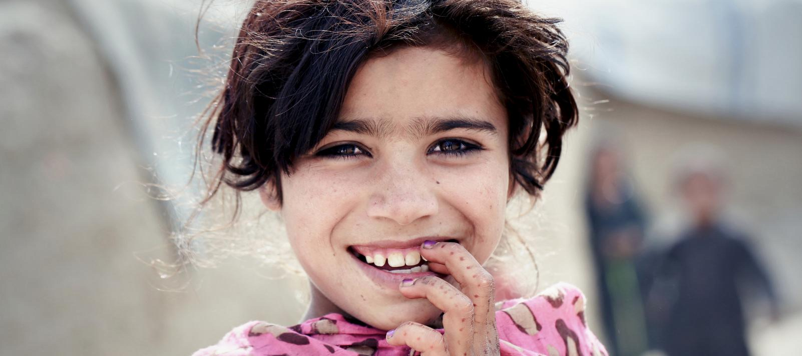 A girl at an camp for internally displaced people in Kabul, Afghanistan.