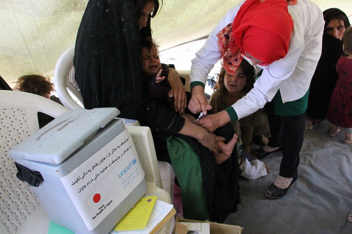 Muslim Abad IDP site, Injil District, Herat, the 10 months old twins, Bacha Khan (boy) and Kabila (girl) received their second round of vaccines.