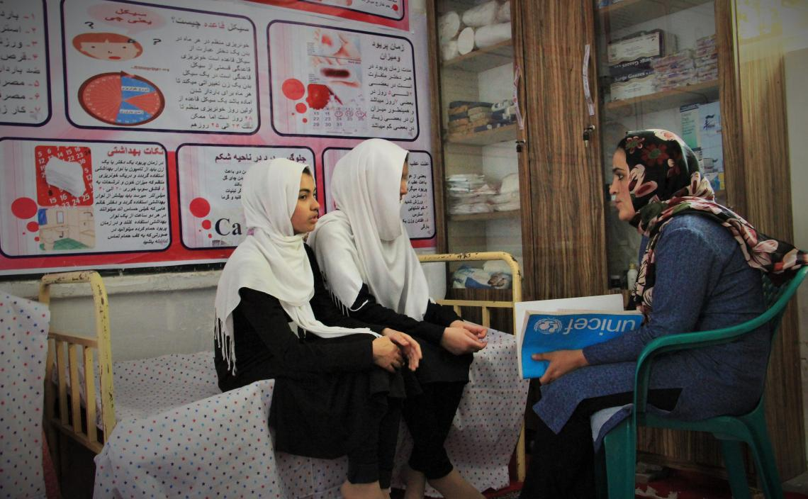 Two students attend a menstrual hygiene management counselling session at a school in Herat, Afghanistan.