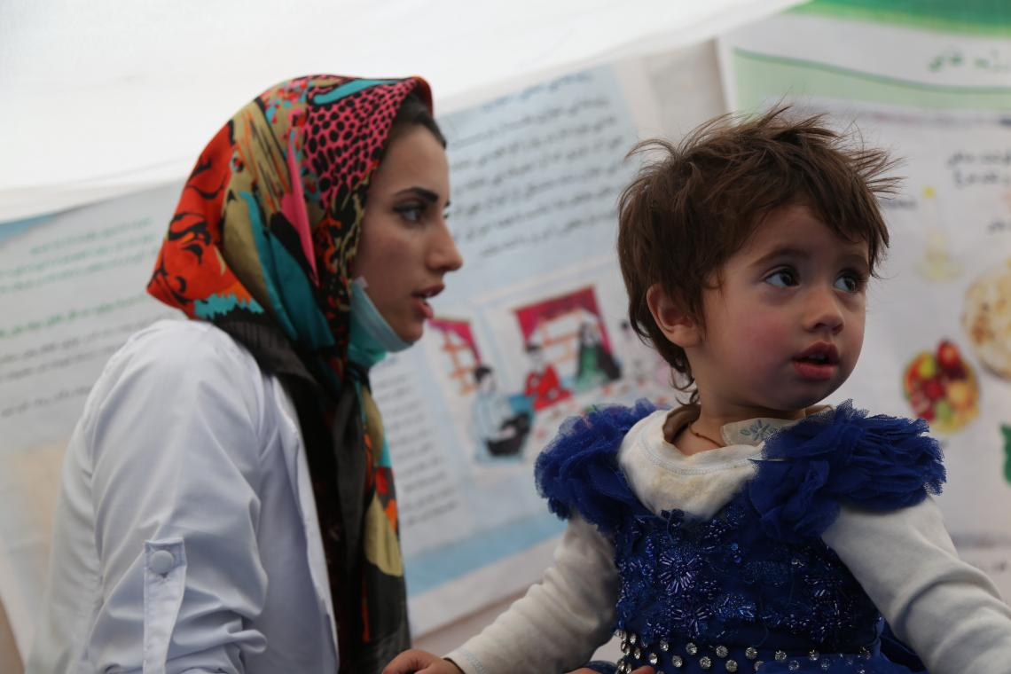 Anita, the midwife and her two-year-old daughter, Sadaf at the health and nutrition clinic in Zaimati camp.