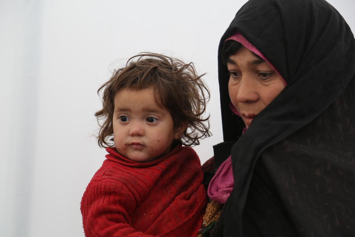 Hajera and her 18 months -old daughter visiting the health clinic in their camp for checkup.