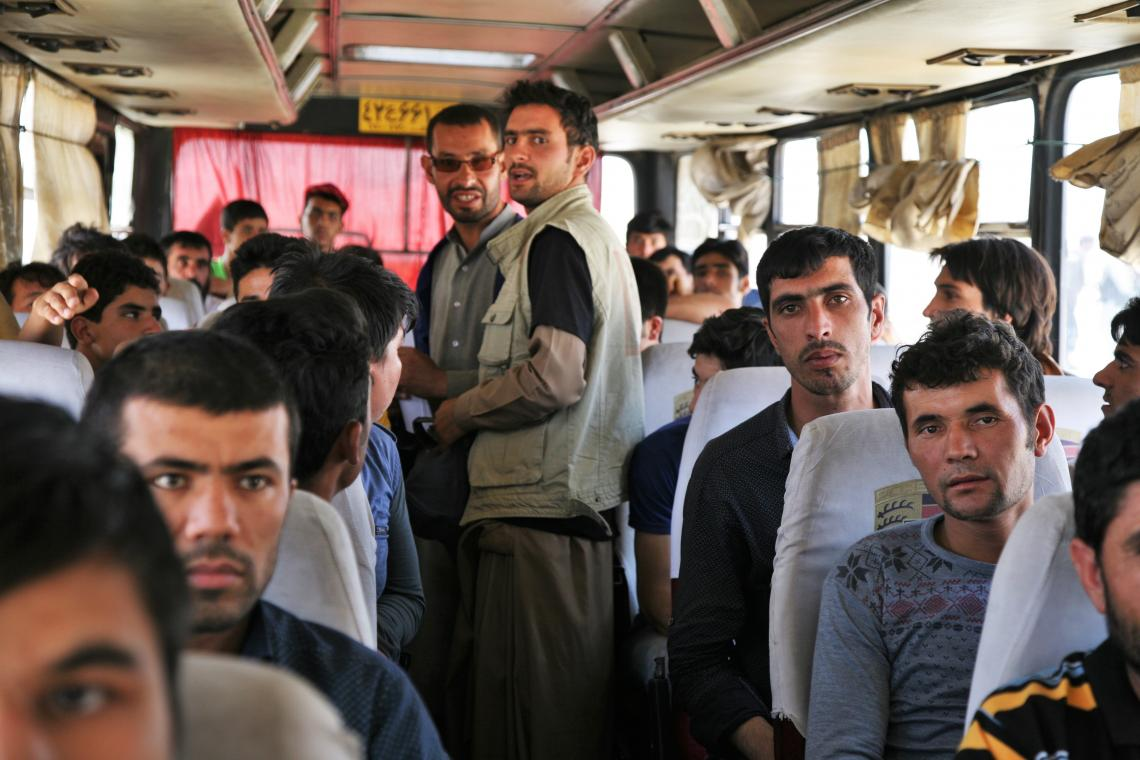 Migrants arriving to Afghanistan in a bus