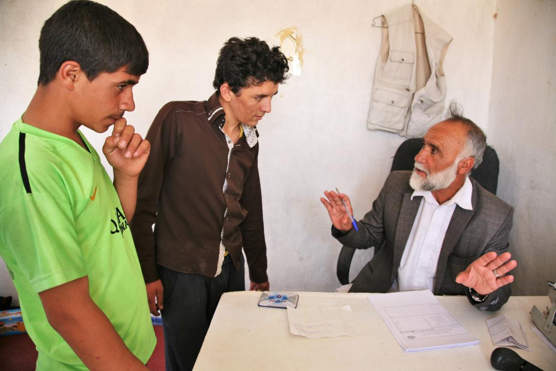 Ahmad and Rahim, two unaccompanied minors being registered to re-enter Afghanistan