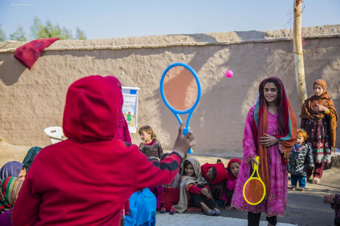 Girls displaced by conflict in neighbouring provinces play at a child-friendly space in Nangarhar province, Afghanistan.