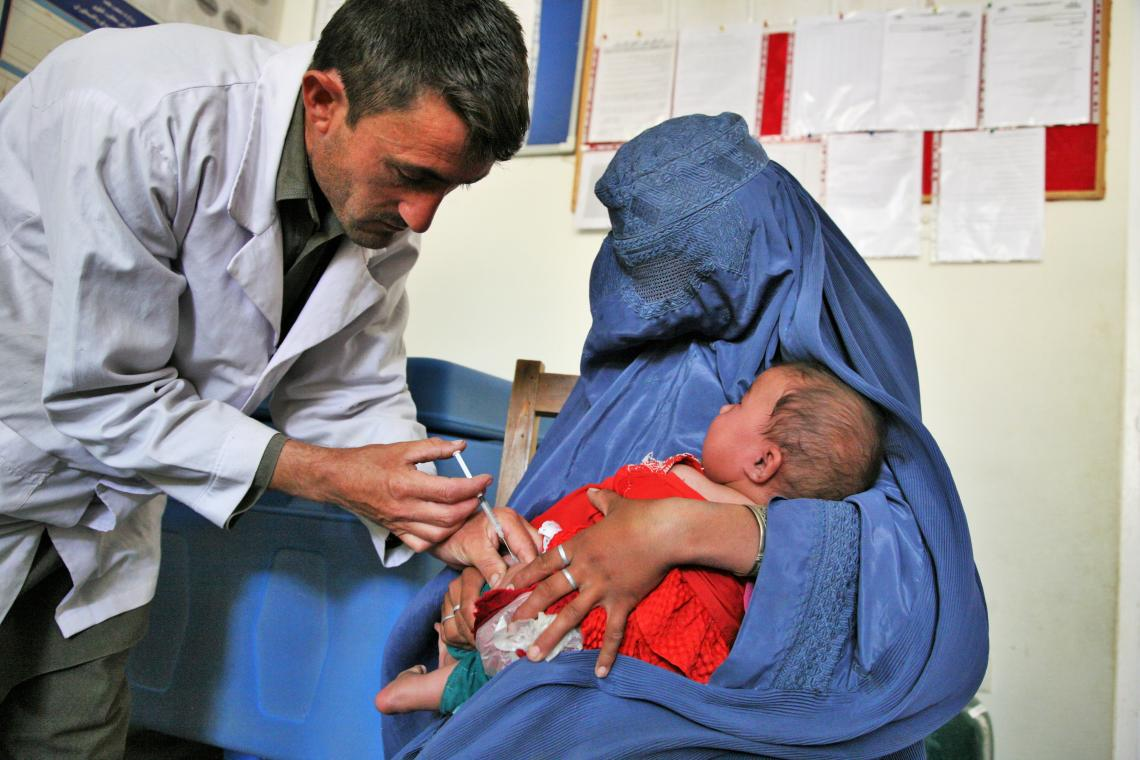 A mother holds her baby as he receives a vaccine at a clinic in Badakhshan, northeastern Afghanistan.