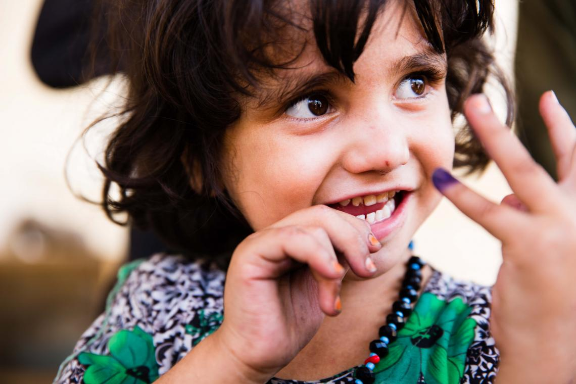 An Afghan girl shows the purple ink mark on her finger, indicating she has been vaccinated against polio during an immunization campaign in Jalalabad, eastern Afghanistan.