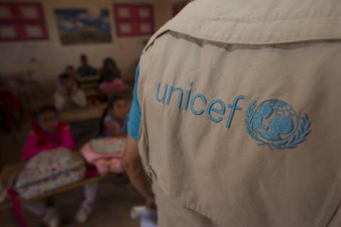 The back of a person wearing a UNICEF branded top