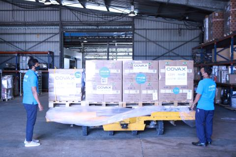 In Malé, Maldives, on 23 February 2021, UNICEF Maldives representatives observe the 100,000 syringes and 1,000 safety boxes that have just arrived from UNICEF's humanitarian warehouse in Dubai.