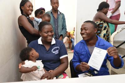 Couple smiles after registering their baby in maternity ward