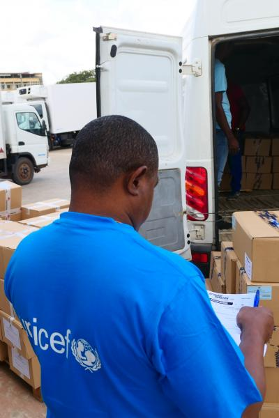 UNICEF Angola Supply Assistant, Aurelio Bernardino, supervises the shipment of vaccination cards in Luanda for 2018's National Immunization Campaign