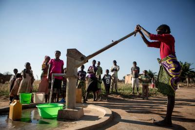 Women uses water pump installed by UNICEF with Andrex funding in a Angolan village