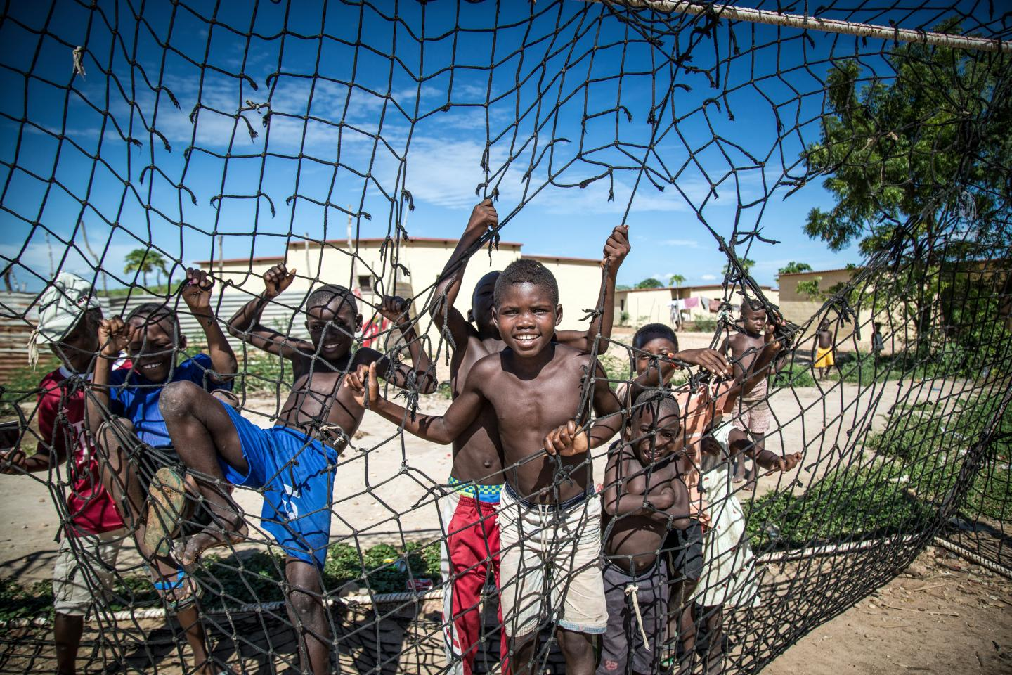 Boys play soccer in Angola