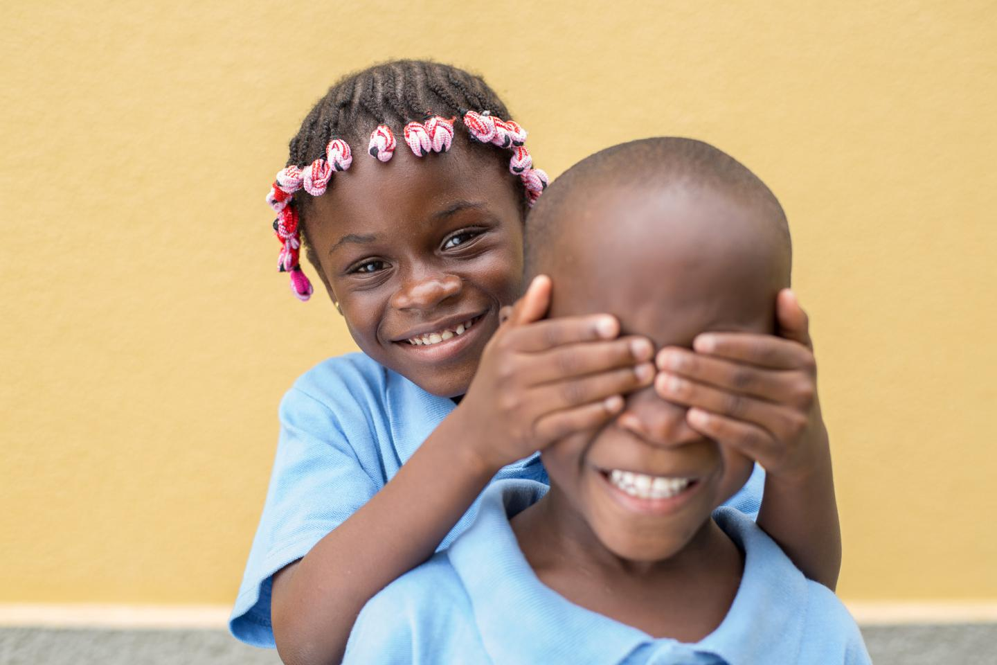A girl and a boy play together in a school in Luanda, Angola
