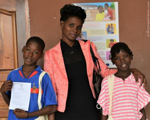 "Mother Ana Quinau takes her 12-year old daughter Delfina and 13-year old son Ferreira to get a birth certificate in their own school, in Luanda, as part or the project ""Registration in Schools"", from the Ministry of Justice and Human Rights with UNICEF support and European Union funding."