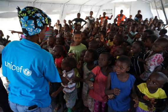 UNICEF Staff plays with kids in a child-friendly space in Cacanda refugee camp, in Lunda Norte, in 2017.