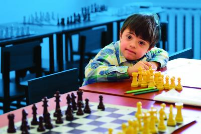 A child with a disability during chess class in the inclusive school in Yerevan.