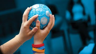 UNICEF blue small ball in child's hands.