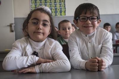 A boy and a girl sitting together in a classroom in the inclusive school in Armenia.