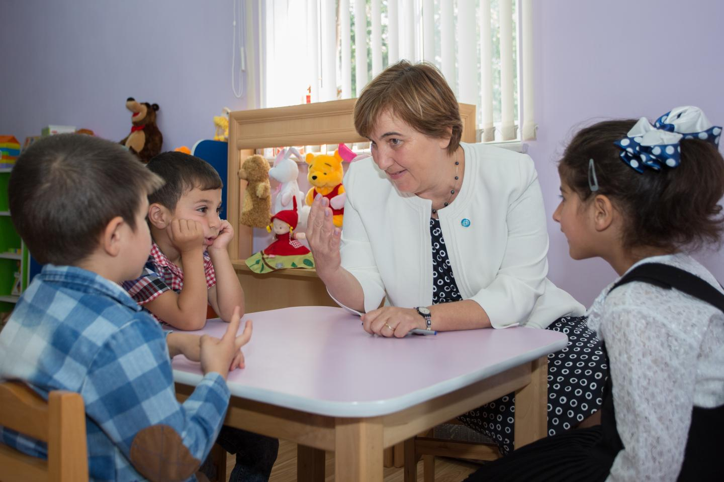 UNICEF's Representative in Armenia, Tanja Radocaj and three children from preschool established by UNICEF Armenia in Marts village, during the discussion.