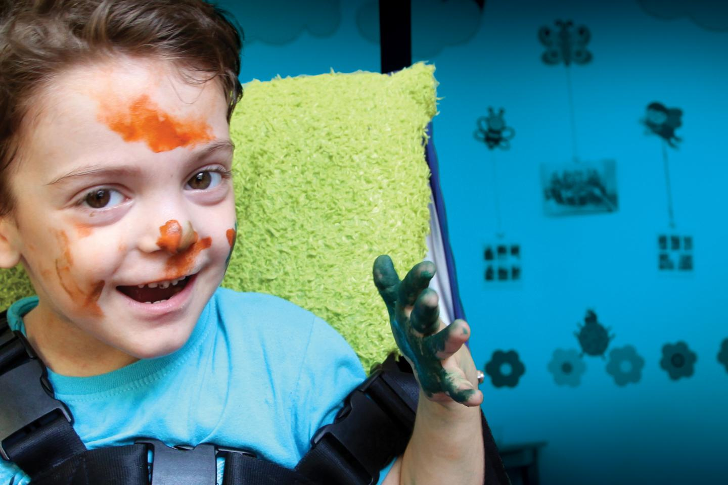 """A boy during art therapy class in Autism National Fund called """"My way""""."""