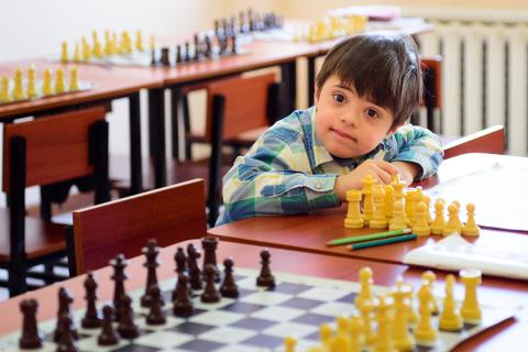 A boy during the chess class in inclusive school in Yerevan, Armenia.