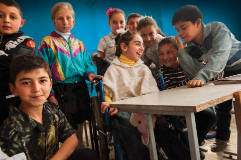 Group of children with and without disabilities in their classroom.