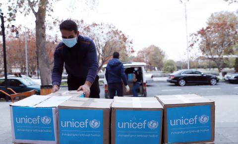 Worker assembling unicef food packages