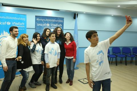 Children are getting ready for World Children's Day. After the rehearsal Samvel is taking a selfie with all participants.