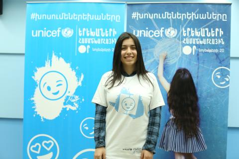 Elen wearing special t-shirt designed for World Children's Day smiles after the rehearsal.