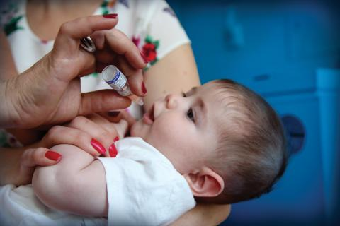 A child receives his routine vaccines.