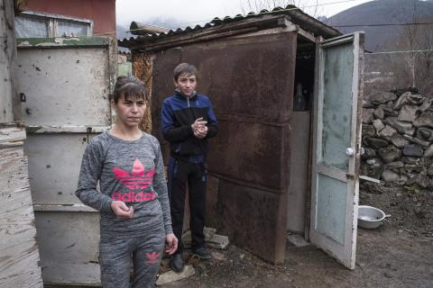 Stepan and his mother in front of their home-container house.