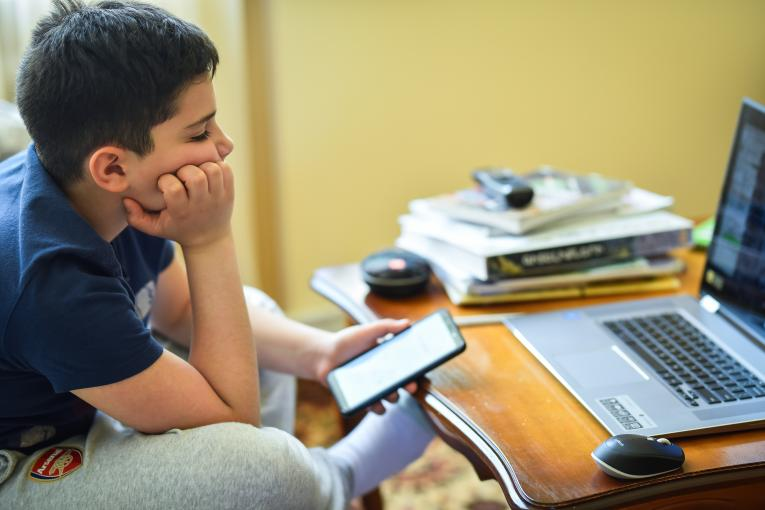A 12-year old boy in front of the PC during online class class_COVID-19