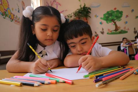 Children draw together at one of the pilot inclusive schools in Baku.