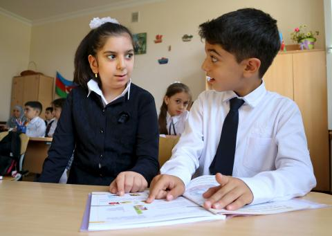 A boy studying together with a girl at one of the four inclusive pilot schools in Baku.