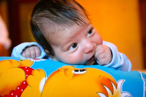 Two-month-old Vural Abdullayev lies on a blanket in his home in Baku.