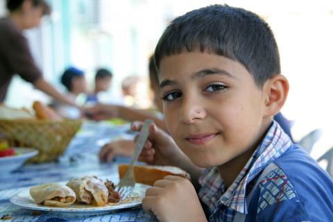 A boy who previously lived on the streets eats a meal at the 'Umid Yeri' ('Place of Hope') Children's Shelter and Rehabilitation Centre in Baku.