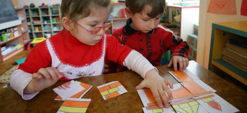 Children do a puzzle at an early childhood development centre in Baku.