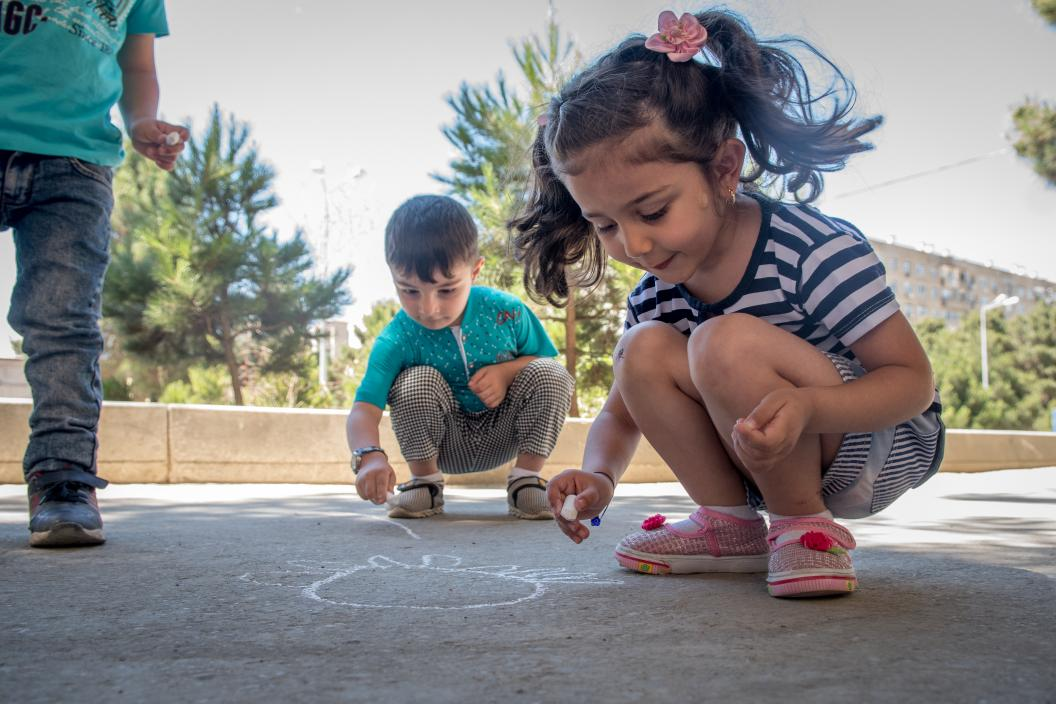 Children playing with chalk at the Early Learning Centre
