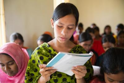 Arjina,14, reading in her class at Chowrapara, Rangpur