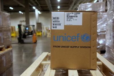 Protective equipment is loaded on a truck at UNICEF's global supply hub in Copenhagen.