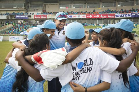 A group of disadvantaged children and national pacer Taskin Ahmed